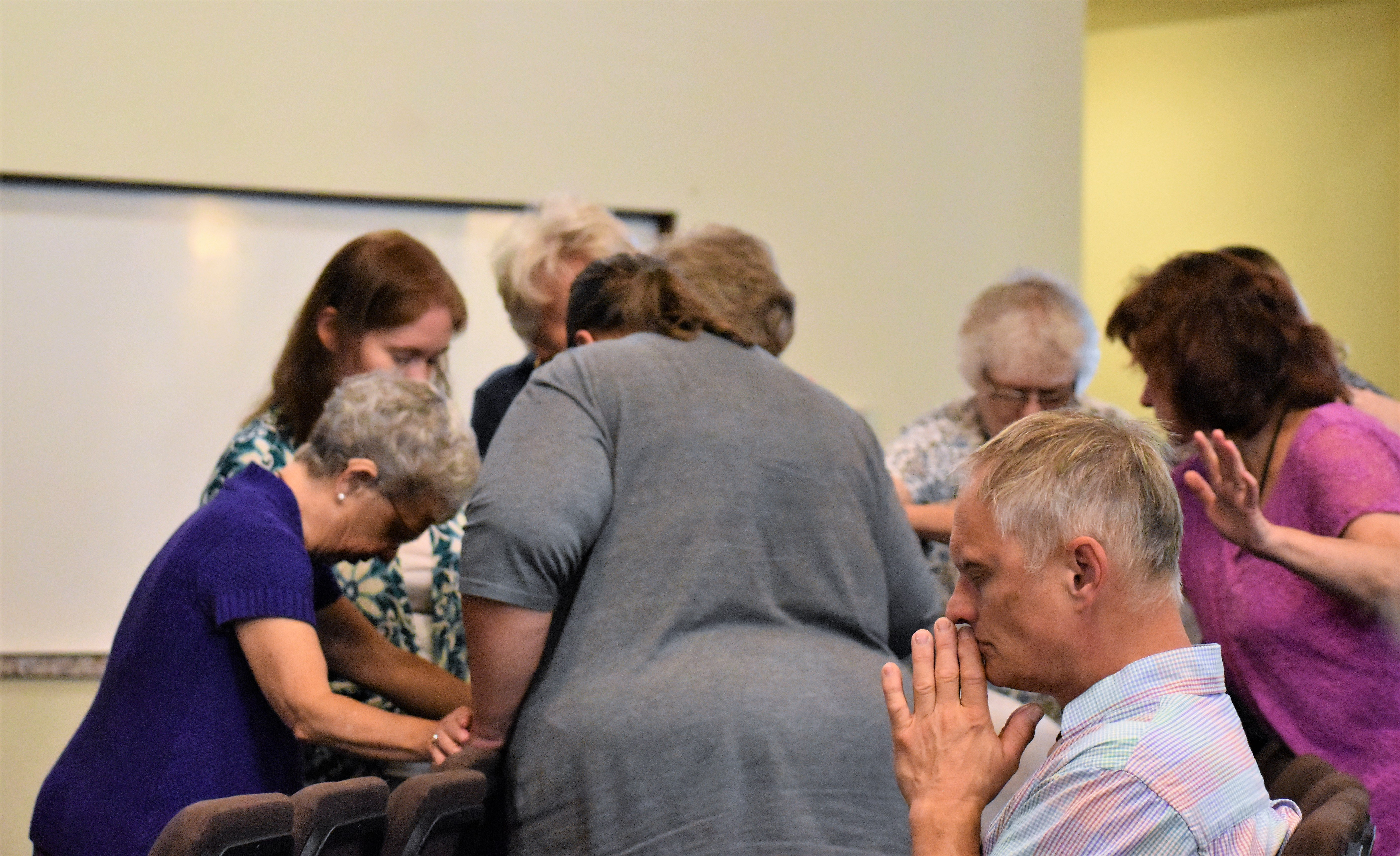 people gathered together to pray for one another